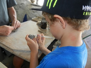 Draven making a little owl out of clay