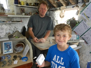 Draven with his finished owl with Doug Francis pottery man at lands End